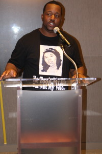 Martinez Sutton discusses the killing of his innocent sister at the hands of a chicago police officer who was acquitted of any wrongdoing during day-long event at the Center for Civil and Human Rights in Atlanta, Georgia